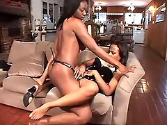 Two sexual black lesbians play with dildo